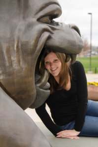 Kelsey Mohring ('12) posing with the Duke Dog statue