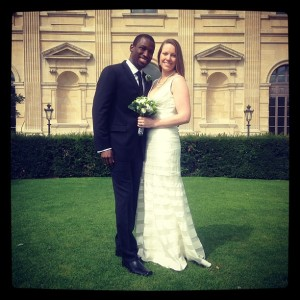 "Levar Stoney (""00) and his bride posing in front of the Louvre. The couple married in Paris last summer."