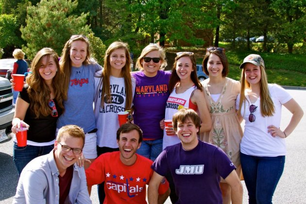 Anthony Baracat ('13) in the red Capital's shirt and JMU friends.