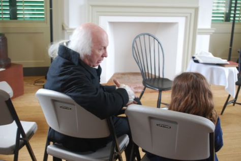 John Douglas Hall, master interpreter of President James Madison chats with a young visitor to Montpelier. (Photo from Belle Grove)