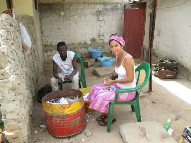 April Muniz with a local Senegalese volunteer, Lamine Ba, ripping paper for theie Paper Briquette project in Diourbel