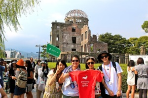 Workshop students at the hypocenter, alongside the Motoyasu River. Standing in front of the Atomic Bomb Dome (A-Dome) are students from Japan, Australia and South Korea. Heather is third from the right.
