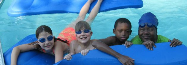Rebekah and Isaac Lohr swimming with Jesco and Dejhanay