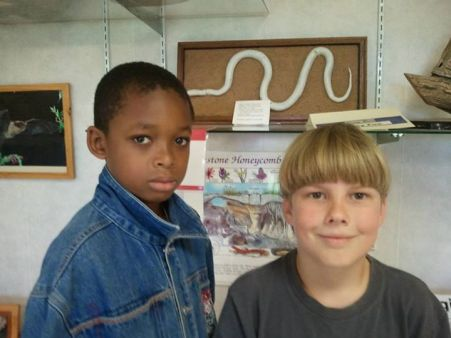 Jesco and Isaac Lohr wanted their picture taken to remember the snake summer.