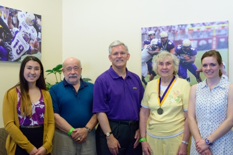 L-R: Katrina Seaver ('17), Charles Seaver, President Alger, Elizabeth Seaver ('56), Jacqueline Herrick ('17). In addition to hosting the game, President Alger inducted Elizabeth into the Bluestone Society during the game.
